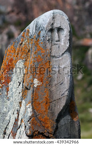Ancient stone statue on the site Kalbak-Tash in the Altai Mountains, Russia.