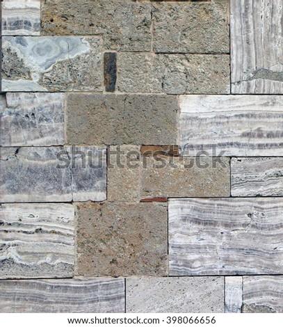 Ancient stone wall of Abbey Sant'Antimo inTuscany, Italy - stock photo