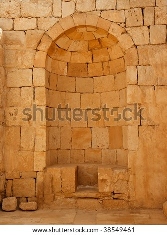 Ancient stone wall with arched niche in Ovdat fortress in Israel - stock photo
