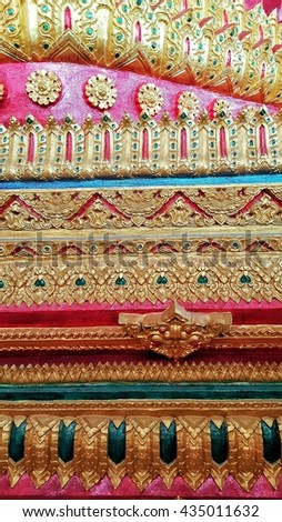 Ancient,striped Thai,traditional Thai style art of stucco in temple rural Thailand - stock photo