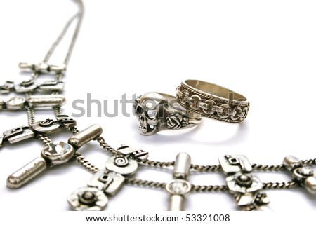 Ancient style necklace and rings isolated on white background.