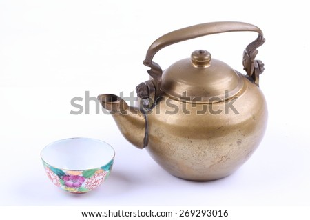 Ancient tea pot and tea cup on white background