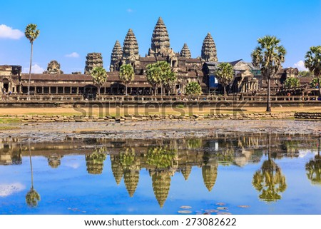 Ancient temple Angkor Wat from across the lake. The largest religious monument in the world. Siem Reap, Cambodia - stock photo