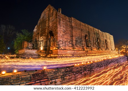 Ancient temple walking with lighted candles in hand around a temple candles light trail of Buddhism Ceremony at temple ruin on Visakha Buja Day Thailand - stock photo