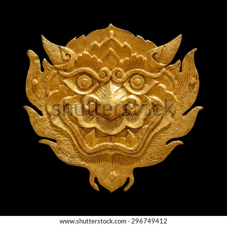 Ancient Thai art golden lion-singha, isolated on black background with clippingpath - stock photo