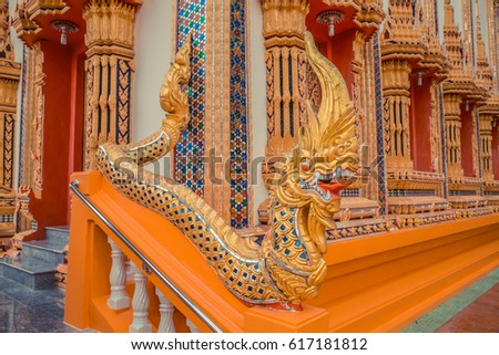 Ancient Thai temple. Wat Kosit Wihan golden Temple Phuket, Thailand. Stairs entrance dragons.