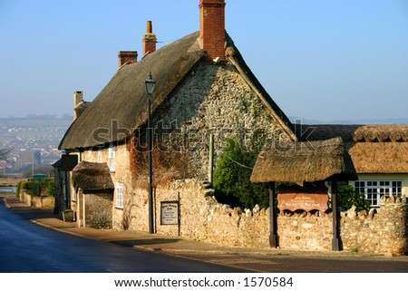 Ancient thatched pub in Devon, England, dates from the twelfth century - stock photo