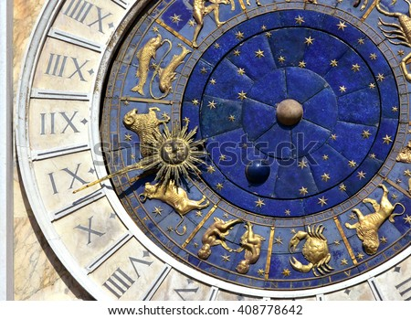 Ancient time and astrology. Detail from Saint Mark's Clock tower in the center of Venice with zodiac signs and roman numbers - stock photo