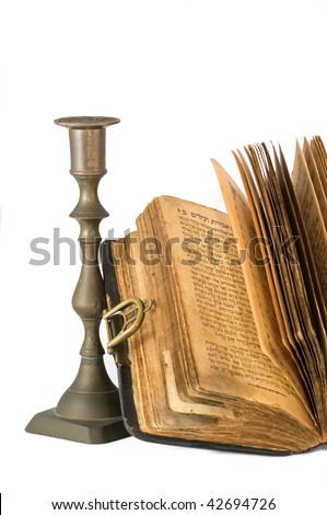 ancient  torah and candlestick over white background - stock photo