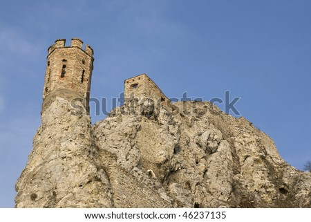 Ancient tower and part of the ruined fortification of the Devin castle near Bratislava, Slovakia. - stock photo