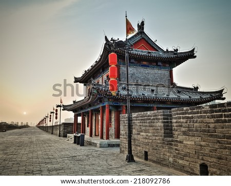 ancient tower closeup on xian city wall at dusk , hdr image  - stock photo
