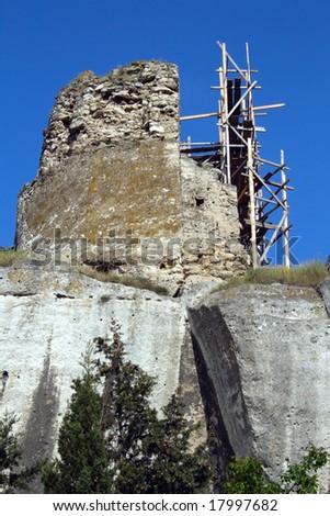 ancient tower under reconstruction in Inkerman, Crimea, Ukraine - stock photo