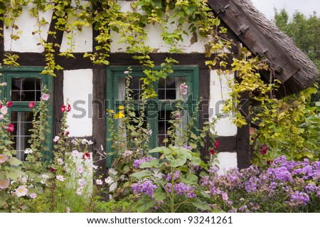 ancient traditional cottage with garden