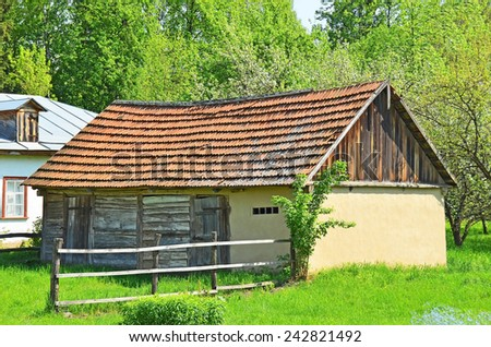 Ancient traditional ukrainian rural wooden barn - stock photo