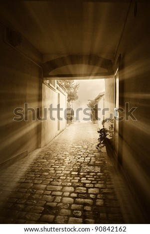 ancient tunnel lit by the rays of the sun - stock photo