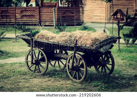 Ancient vehicle on a farm - stock photo