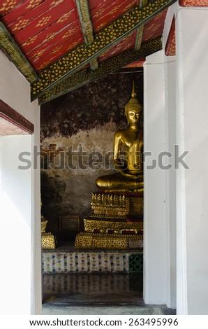 Ancient Veranda of Gilt Buddha Images at Wat Suthat, Bangkok of Thailand. - stock photo