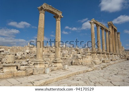 Ancient vertical columns with capital along the Roman road in Jerash, Jordan