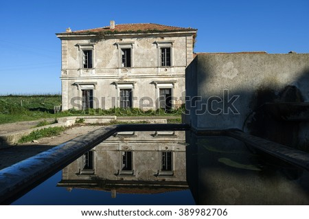 ancient villa reflected in the water, Sicily, Italy, Europe