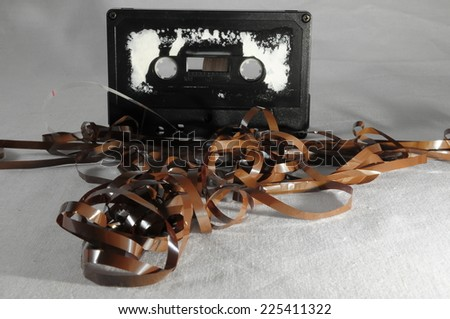 Ancient Vintage Used Musicassette over a White Background - stock photo