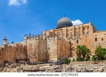 Ancient walls and Al Aqsa Mosque dome under blue sky in Old City of Jerusalem, Israel. - stock photo
