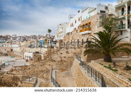 Ancient walls and living houses in Medina. Tangier, Morocco - stock photo