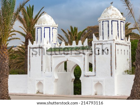 Ancient white gate to the park in Tangier, Morocco - stock photo