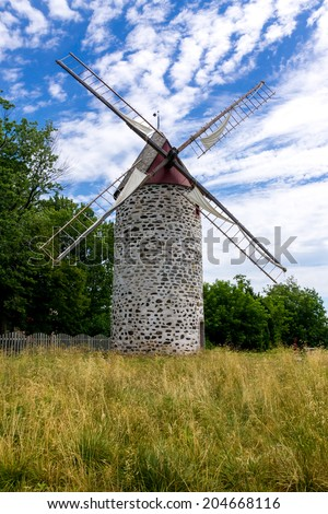 Ancient Windmill from Pointe Aux Trembles Year of Construction 1719, sixth largest windmill in Quebec,Canada - stock photo