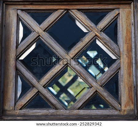 Ancient  window. Closeup of old wooden window frame. - stock photo