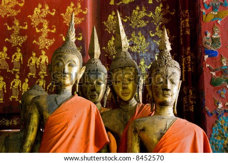 ancient wooden buddha statues - stock photo