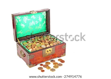 Ancient wooden chest full of euro coins - stock photo