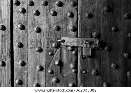 Ancient wooden door with latch and lock