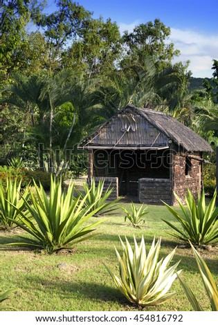 Ancient wooden hut in park - so lived on Mauritius earlier - stock photo