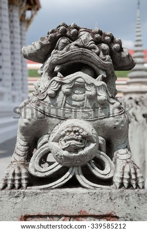 Ancint Chinese Lion Stone Statue Is Outdoor Decoration of Wat Arun (Temple of Dawn) at Bangkok, Thailand.