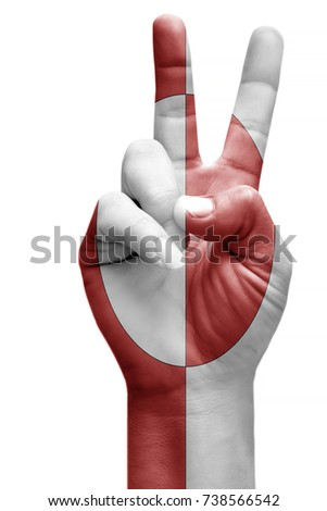 and making victory sign, Greenland painted with flag as symbol of victory, win, success - isolated on white background