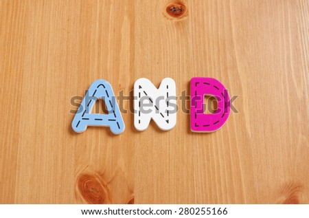 AND, spell by woody puzzle letters with woody background