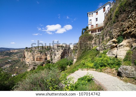 Andalusia mountainous landscape with cobbled path and high cliffs of Ronda in southern Spain, Malaga province.