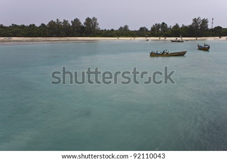 ANDAMAN ISLANDS, INDIA - AUGUST 29: Boatmen in a traditional boats on August 29, 2011 at Andaman Islands, India. Andaman island includes some two hundred islands in the Bay of Bengal. - stock photo