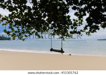 Andaman sea beautiful Kamala beach in Phuket Thailand, with silhouette tree and swing in foreground.    - stock photo