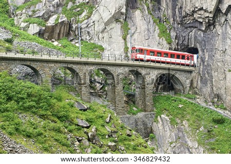 ANDERMATT, SWITZERLAND - June 21, 2015: The railroad bridge Teufelsbruecke - Devil's bridge.The Schollenen Gorge is an important route and the shortest transit to the St. Gotthard Pass.  - stock photo