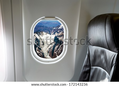 Andes Mountains, Chile in the aircraft's porthole - stock photo