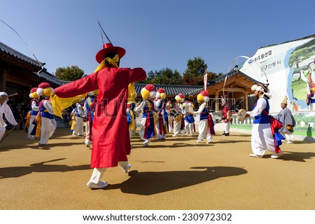 ANDONG-SI KOREA OCTORBER 26: People are performing folk dance at Hahoe Village on octorber 26 2013, Andong-si, Korea.  - stock photo