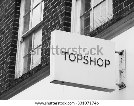 Andover, high Street, Hampshire, England - October 22, 2015: Topshop and Topman ladies and gentlemen high street fashion store sign over shop - stock photo
