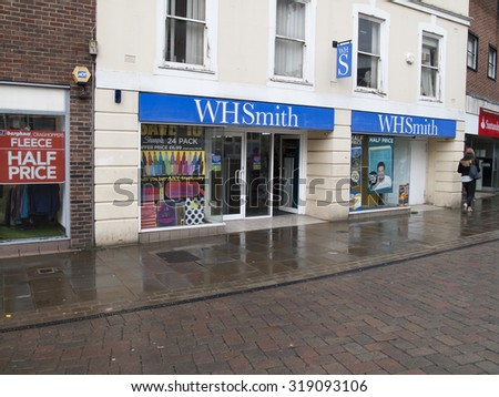 Andover, High Street, Hampshire, England - September 21, 2015: W H Smith retail store, late afternoon rain soaked street - stock photo