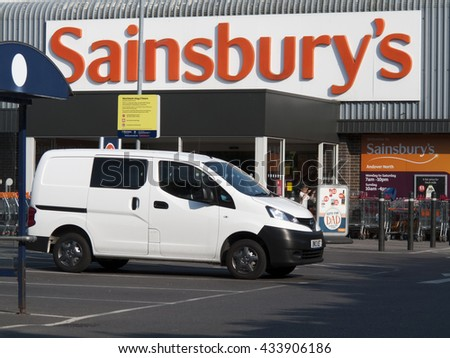 Andover, Shepherds Spring Lane, Hampshire, England - June 08, 2016: Sainsburys supermarket store entrance and car park