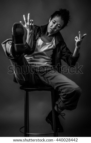Androgen. Androgynous character on a gray background. Man or woman. Military style. Very sharp. Black and white.