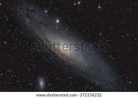 Andromeda Galaxy (M31) and its satellite galaxies (M32 and M110) in Andromeda constellation - stock photo