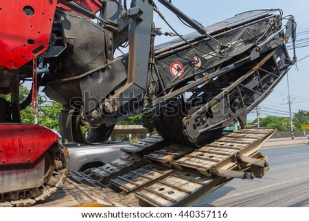 Ang Thong, Thailand - May 2, 2016 : Sugar cane harvesters on trailer truck for move to work.
