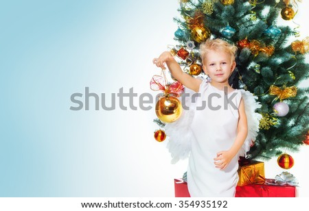 Angel Boy And Christmas Tree - stock photo