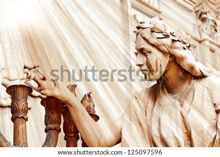 Angel crying at La Recoleta Cemetery in Buenos Aires, with divine rays falling over it. With room for text. - stock photo